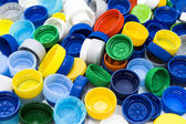 Plastic caps background — Stock Photo