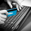 Stock Photo: Online shopping with credit card on laptop