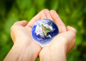 Earth in hands. Glass World — Stock Photo
