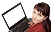 Beautiful young lady using laptop — Stock Photo
