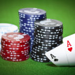 Poker table with two cards and gambling chips - Stock Photo