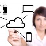 Young woman drawing cloud computing diagram — Stock Photo