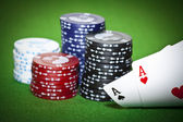 Poker table with two cards and gambling chips — Stock Photo