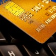 Credit card on computer keyboard. Online payment - Stock Photo