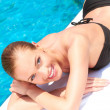Beauty lying next to swimming pool — Stock Photo