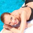 Beauty lying next to swimming pool — Stock Photo