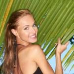 Gorgeous girl standing next to palm tree — Stock Photo #10007909
