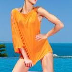 Fashion woman posing next to pool — Stock Photo #10007914