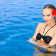 Young woman standing in swimming pool — Stock Photo