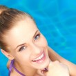 Close up of happy girl in swimming pool — Stock Photo #10007932