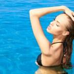 Sensual woman in swimming pool — Stock Photo #10007933