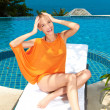 Fashion woman posing next to pool — Stock Photo #10008006