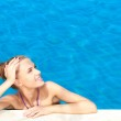 Cute in swimming pool with copy space — Stock Photo #10008007