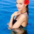 Tropical girl with flower on her ear — Stock Photo #10008039