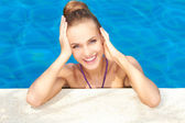 Cute in swimming pool with copy space — Stock Photo