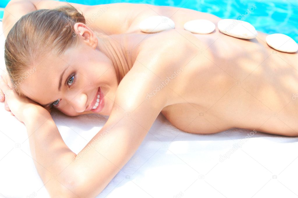 Woman taking spa treatment with hot stones — Stock Photo #10007912