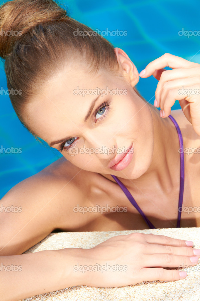 Close up of young adorable woman in swimming pool  Stock Photo #10007918
