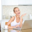 Laughing woman sitting at laptop computer — Stock Photo #10067103
