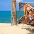 Attractive woman relaxing in a hammock — Stock Photo #10244826