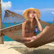 Beautiful cute girl relaxing in a hammock — Stock Photo
