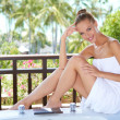 Woman in towel on bathtub - Stockfoto