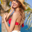 Happy young woman posing in straw hat — Stock Photo #10244905