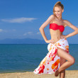 Adorable woman standing at the tropical beach — Stock Photo