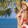 Joyful girl in red bikini posing at the beach — Stock Photo