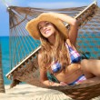 Beautiful tourist relaxing in a hammock — Stock Photo