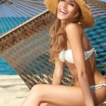 Vivacious happy woman in bikini on hammock — Stock Photo