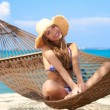 Woman with lovely smile sitting in a hammock — Stock Photo
