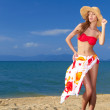 Coy blonde beauty in a red bikini — Stock Photo #10245295