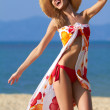 Carefree young woman on the beach — Stock Photo #10245395