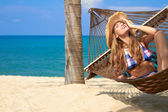 Attractive woman relaxing in a hammock — Stock Photo