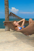Woman enjoying the peace of a tropical beach — Stock Photo