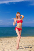 Beautiful female posing in red bikini — Stock Photo