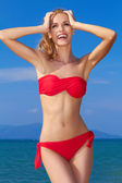 Beautiful woman in red bikini — Stock Photo