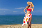 Coy blonde beauty in a red bikini — Stock Photo
