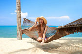 Vivacious beautiful woman in hammock — Stock Photo