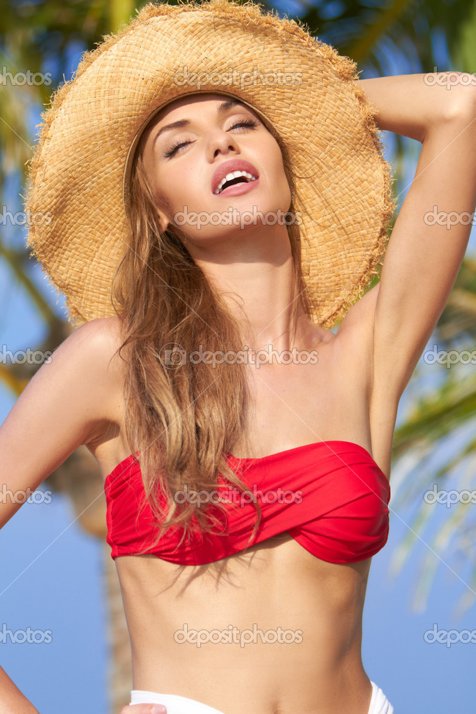 Beautiful woman in straw hat and bikini with her head tilted back ,  her lips parted and her eyes closed — Stock Photo #10244741