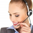 Pretty female businesswoman talking headset — Stock Photo