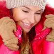 Young woman wearing winter jacket scarf and cap — Stock Photo #8900989
