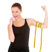 Fitness woman with measure tape — Stock Photo
