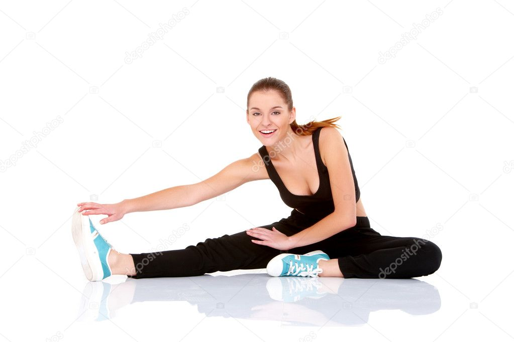 Beautiful fitness woman doing stretching exercise on white — Stock Photo #8900946
