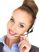 Pretty female businesswoman talking headset — Stock Photo