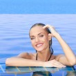 Smiling Woman Reflected In Pool — Stock Photo