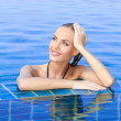 Stock Photo: Smiling Woman Reflected In Pool