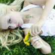 Stock Photo: Beautiful sexy young woman outdoors, lying in the grass, relaxin