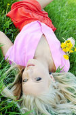 Beautiful sexy young woman outdoors, lying in the grass, relaxin — Stock Photo