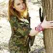 Stock Photo: Military woman in the forest
